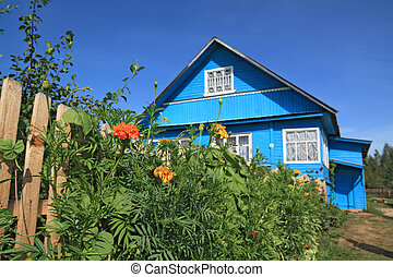summer flowerses near rural wooden building