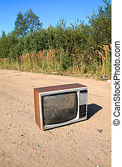 old television set on rural road