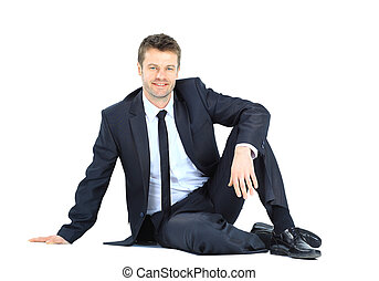 Portrait of business man sitting on the floor isolated over...