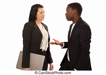 Business conversation - Two mixed race business people in...