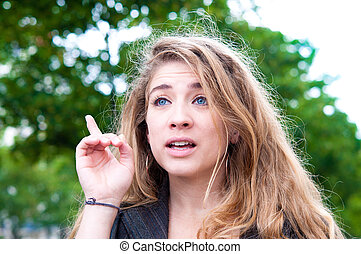 young woman with her finger up