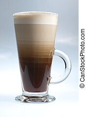 Layered white coffee in glass on the white/azure background