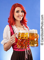 Beautiful woman serving beer at Oktoberfest - Photo of a...