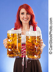 Oktoberfest girl serving beer - Photo of a beautiful female...