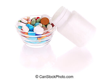 Bottle and saucer with many-colored pills - Transparent...