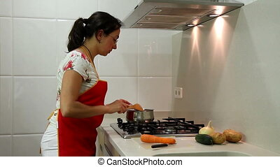 In the kichen - Young housewife working in the kitchen