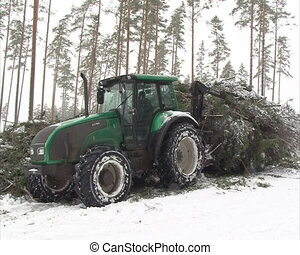 tracto unload tree branch - tractor with crane unload...