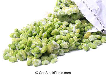 Frozen edamame also known as soybeans coming out of a...