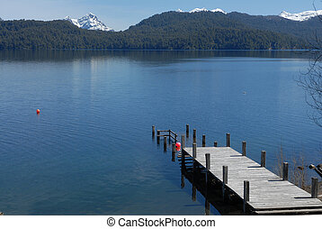 Wood pier, lake and mountains in Argentina