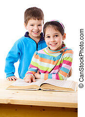 Two kids reading the book together