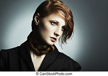 Fashion photo of a beautiful young red-haired woman