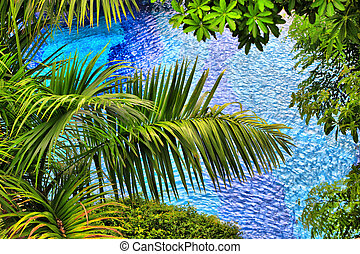Background from palm branches over pool