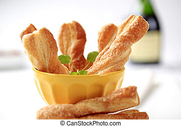 Puff pastry twists sprinkled with sugar