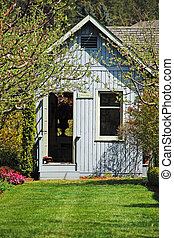 Blue garden shed - Wooden blue garden shed in the spring