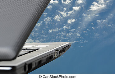 Abstract Cloud Computing - Black laptop on blue sky concept