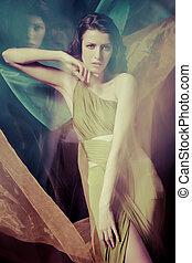 Bizarre - Fashion portrait of brunette lady in long dress...