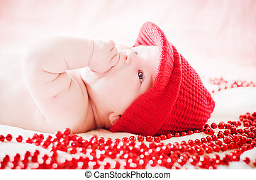 cute baby in red winter hat