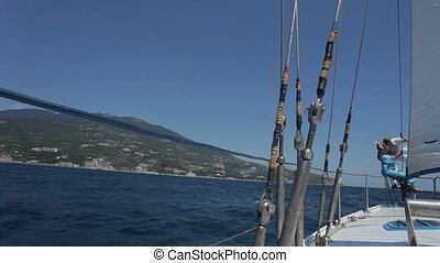 Young couple is on bow of yacht HD - Young couple is on bow...