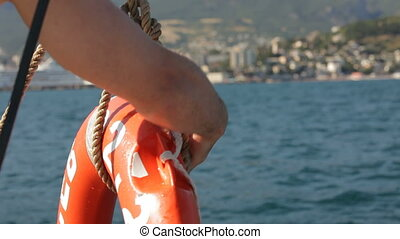 Lifebuoy HD - Sailor ties rope to the lifebuoy Close up