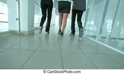 Business team - Business people marching ahead through the...