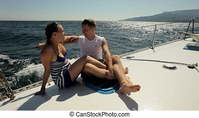 Man with girlfriend on the yacht