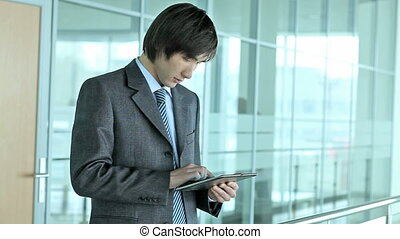 Business guy with tablet-pc