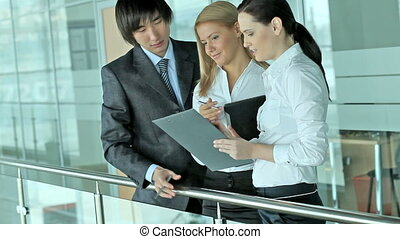 Discussion - Business team of three holding a meeting and...