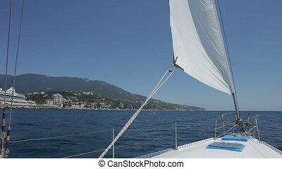 Bow of the yacht HD - Sail yacht  is swinging on wave.