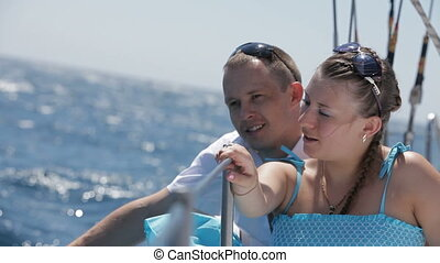 Young couple on a yacht HD - Young couple is traveling on a...