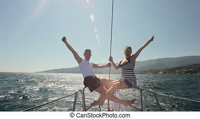 Sea trip on the yacht HD - Happy family sitting on the bow...