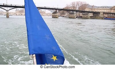 Seine River and european Flag - Navigation on Seine River,...