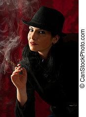 Retro woman smoking in night
