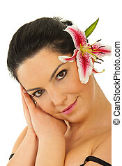 Beauty woman with pink lily in hair