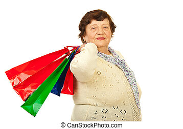 Elderly woman at shopping - Elderly woman holding colorful...