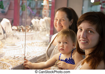 Women with child  looking jewelry  counter