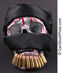 skull - A human skull with a black headscarf and 9mm...