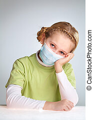 Quarantine - A little girl sitting in protective mask