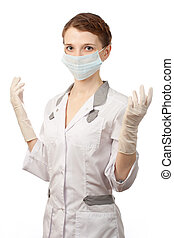 Nurse with sterile gloves and medical mask