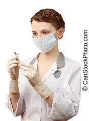 Nurse in sterile gloves and medical mask