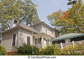 Old Wood Siding Farmhouse in Trees - An old wood siding...