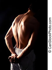 muscular man - back of a young muscular man, isolated...