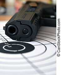Gun and target, macro with small depth of field