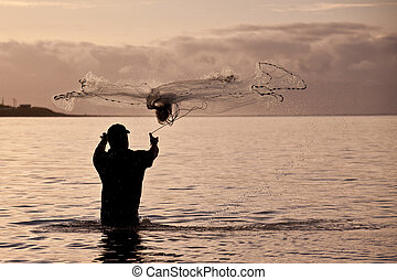 Fisherman net throwing - Fisherman throwing fishing net out...