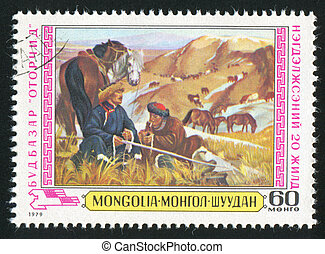 Herdsmen and horses - MONGOLIA - CIRCA 1979: stamp printed...