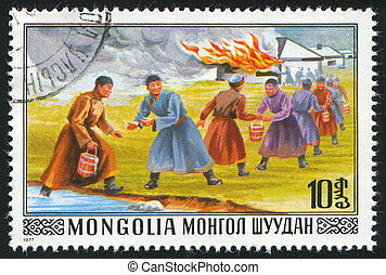 Bucket Brigade Fighting Fire - MONGOLIA - CIRCA 1977: stamp...