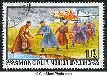 Bucket Brigade Fighting Fire - MONGOLIA - CIRCA 1977: stamp...