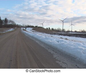 spring wind mill sky - Gravel road in spring melting snow...
