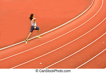 athlete running on the racing track - picture of an athlete...