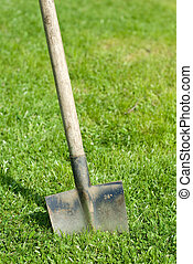 spade - a spade stuck in the grass