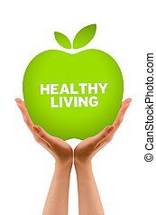 Healthy Living - Hands holding a Green Healhty Living Apple...